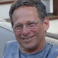 photo of smiling older man with glasses