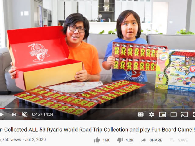 Screenshot of YouTube video with young boy and father facing camera holding toys